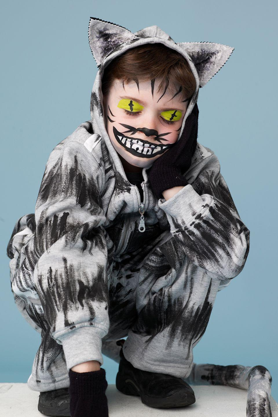 """<p>Black paint will turn a grey sweatsuit into the<em> purrr</em>-fect <em>Alice in Wonderland</em> costume. Add a few extra feline touches, like felt ears and gloved paws, as a finishing touch.</p><p><a href=""""https://www.womansday.com/home/crafts-projects/how-to/a8637/halloween-costume-how-to-cheshire-cat-110888/"""" rel=""""nofollow noopener"""" target=""""_blank"""" data-ylk=""""slk:Get the Cheshire Cat tutorial."""" class=""""link rapid-noclick-resp""""><strong><em>Get the Cheshire Cat tutorial.</em></strong></a></p>"""