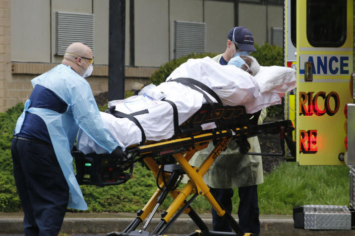 Members of the Henrico County Fire Department Emergency Services transport a patient