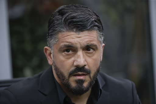 FILE - In this April 2, 2019 file photo, then AC Milan coach Gennaro Gattuso follows the Serie A soccer match between AC Milan and Udinese, at the San Siro stadium in Milan, Italy. Napoli hired former AC Milan coach Gennaro Gattuso on Wednesday, Dec. 11, 2019, the day after sacking Carlo Ancelotti after Napoli beat Gent 4-0 to progress to the last 16 of the Champions League and end a nine-match winless run. (AP Photo/Luca Bruno, file)