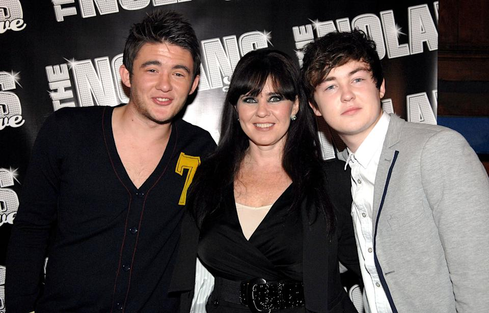 MANCHESTER, ENGLAND - OCTOBER 13:  Singer Coleen Nolan (C) and sons Shane Richie, Jr. (L) and Jake Richie attend The Nolans Aftershow party at Via on October 13, 2009 in Manchester, England.  (Photo by Shirlaine Forrest/WireImage)