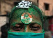 A supporter of the Chief Minister of West Bengal state and the Chief of Trinamool Congress (TMC) Mamata Banerjee reacts, in Kolkata