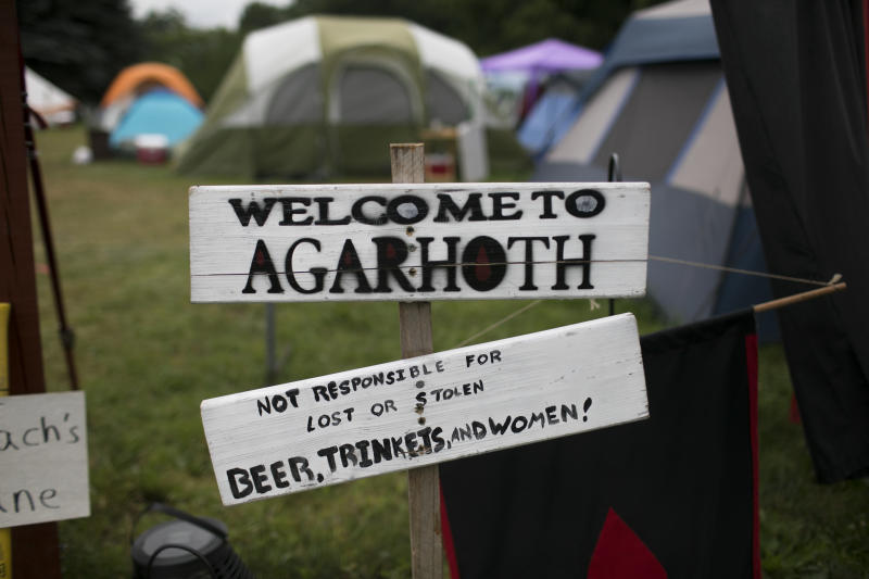 "A ""Welcome to Agarhoth"" sign at a camp entrance. (Maddie McGarvey for HuffPost)"