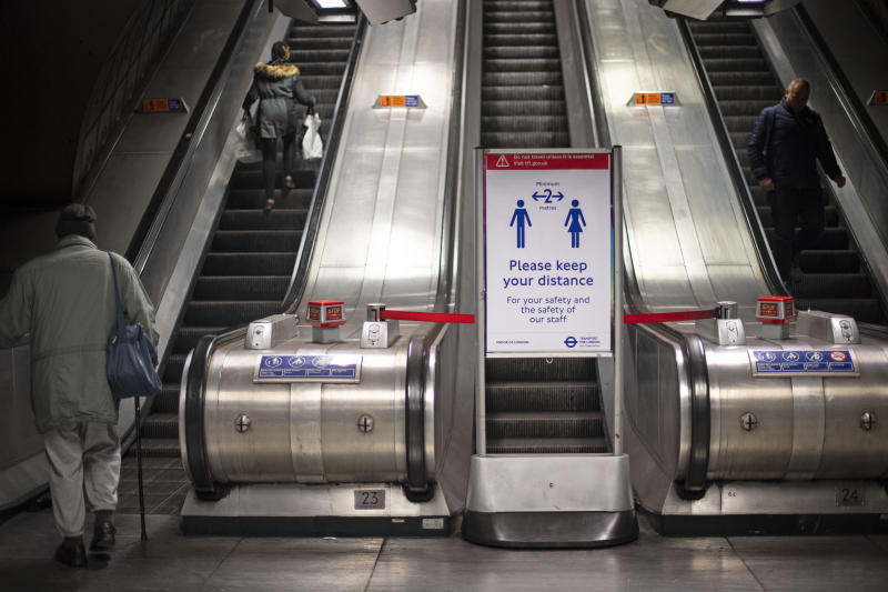 A social distancing information board at Waterloo tube station on the London Underground during what would normally be the evening rush hour, as the UK continues in lockdown to help curb the spread of the coronavirus.