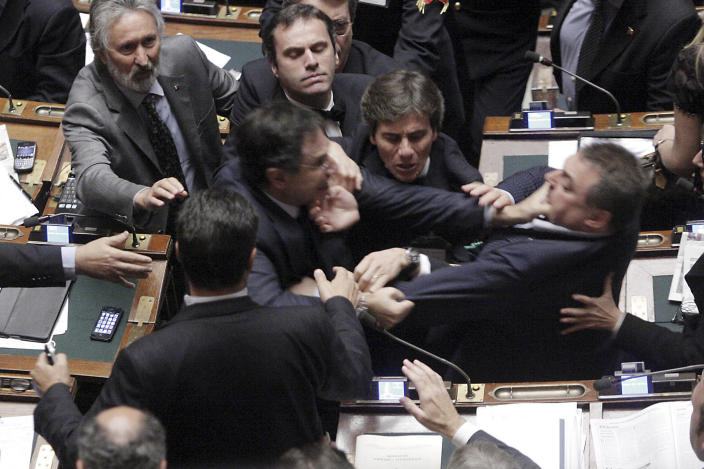 Claudio Barbato (L), a member of the opposition FLI party, fights with Fabio Ranieri (R) from the Northern League in Parliament in Rome October 26, 2011. The Italian deputies exchanged blows in parliament on Wednesday as tensions over a tough economic reform programme came to a head. (REUTERS/Ansa/Giuseppe Lami)
