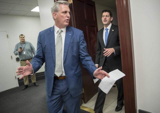 Majority Leader Kevin McCarthy, R-Calif., left, and Speaker of the House Paul Ryan, R-Wis., leave a closed-door Republican Conference meeting as Congress prepares to vote on the biggest reshaping of the U.S. tax code in three decades, on Capitol Hill, in Washington, Tuesday, Dec. 19, 2017. After passing the measure on Tuesday afternoon, House members will have to re-vote on Wednesday before sending the bill to the Senate. (AP Photo/J. Scott Applewhite)