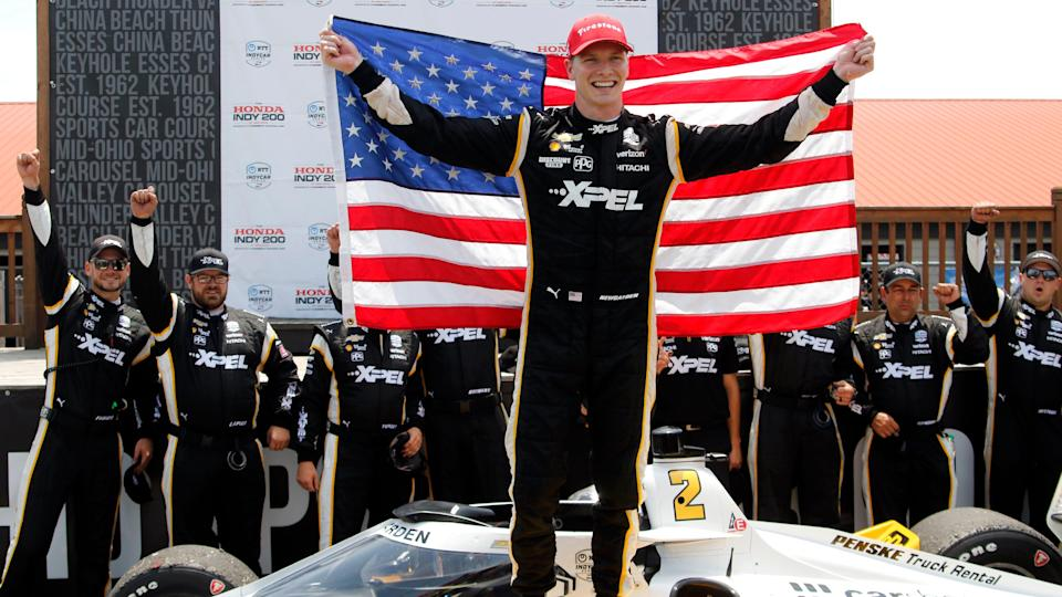 Josef Newgarden celebrates in victory lane after winning the IndyCar race at Mid-Ohio Sports Car Course on July 4.
