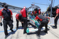Tony Kanaan's team make adjustments to his car as he participates during practice for the IndyCar auto race at Texas Motor Speedway in Fort Worth, Texas, Saturday, June 6, 2020. (AP Photo/Tony Gutierrez)