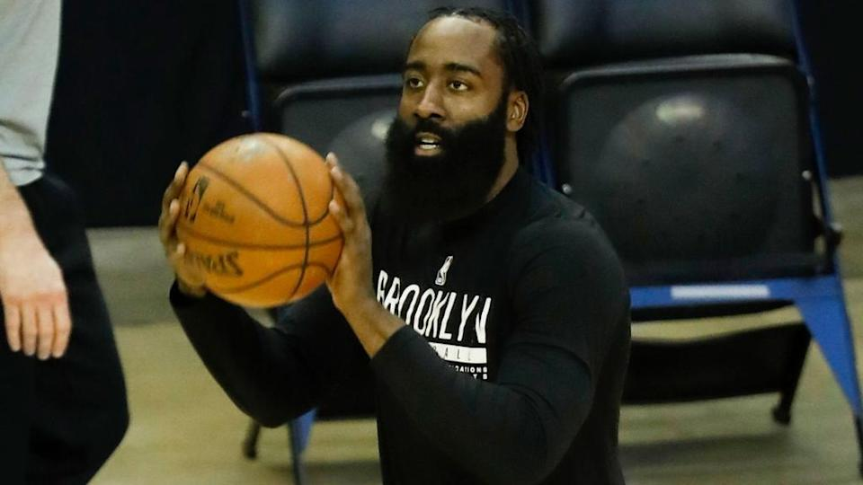 James Harden in black warmup shirt