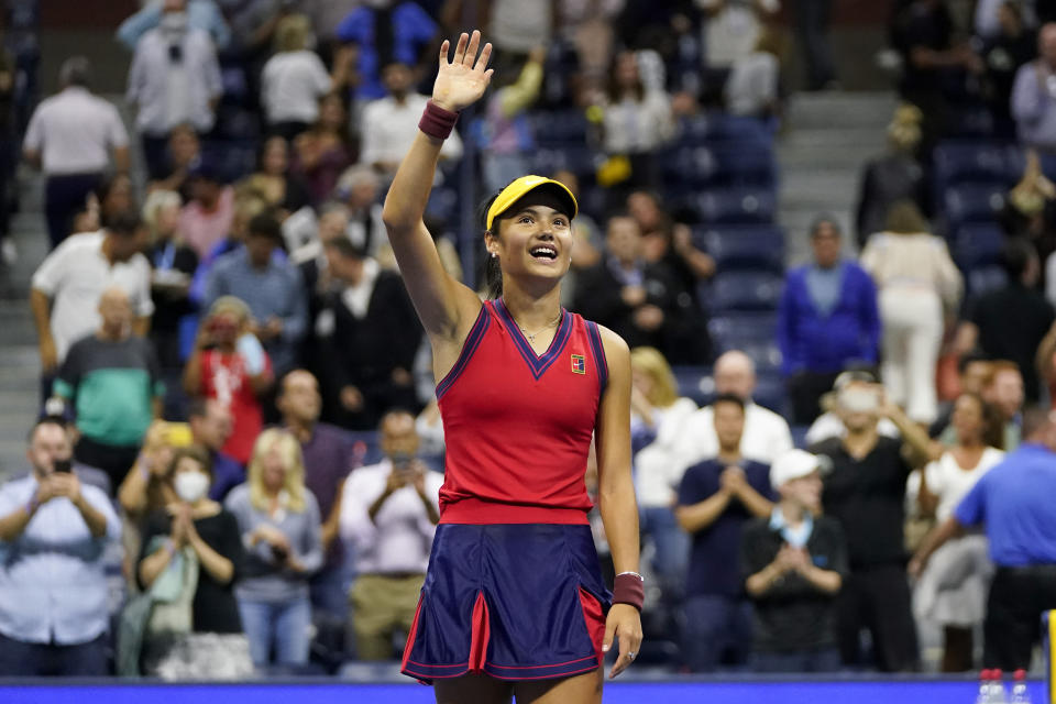 Emma Raducanu, of Great Britain, waves to the crowd after defeating Maria Sakkari, of Greece, during the semifinals of the US Open tennis championships, Thursday, Sept. 9, 2021, in New York. (AP Photo/Frank Franklin II)