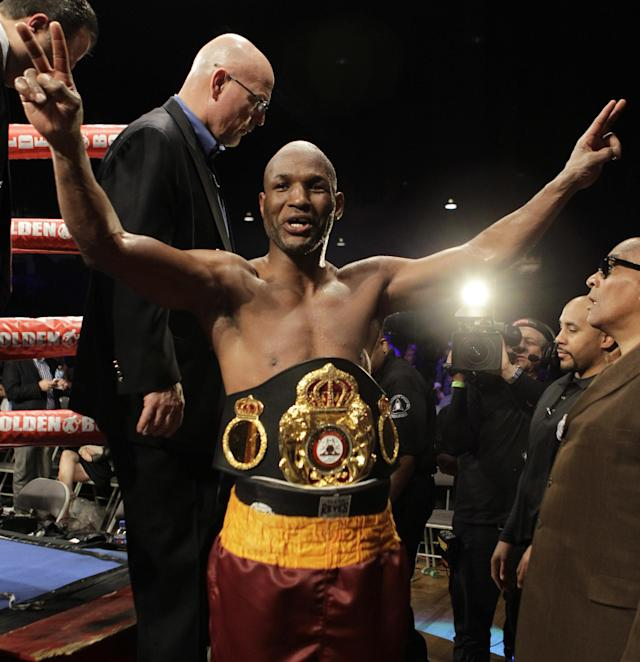 Bernard Hopkins, of the United States, leaves the ring after defeating Beibut Shumenov, of Kazakhstan, by a split decision after their IBF, WBA and IBA Light Heavyweight World Championship unification boxing match, Sunday, April 20, 2014, in Washington. Hopkins won by a split decision. (AP Photo/Luis M. Alvarez)