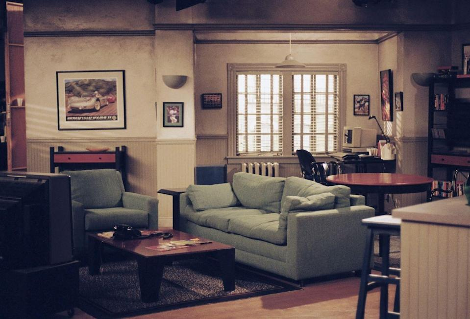 """<p>The set of Jerry's home depicted a typical New York City apartment during the time. But super fans have spotted some inconsistencies on the set over the years, like <a href=""""https://screenrant.com/seinfeld-hidden-details-jerrys-appartment/"""" rel=""""nofollow noopener"""" target=""""_blank"""" data-ylk=""""slk:the bookshelf and the door number"""" class=""""link rapid-noclick-resp"""">the bookshelf and the door number</a>.</p>"""