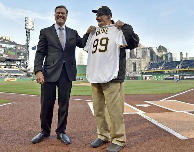 Pittsburgh Pirates president Frank Coonelly (left) honors usher Phil Coyne on his 99th birthday before an April 27, 2017 game at PNC Park. (AP)