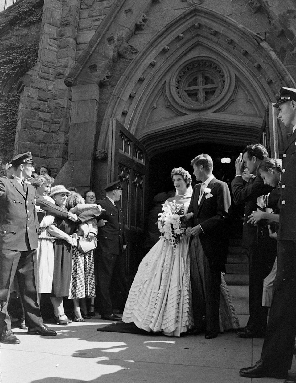 <p>The happy couple posed for photos before continuing on to the reception. It is said that it took the couple two hours to greet all of their hundreds of guests in the receiving line.</p>