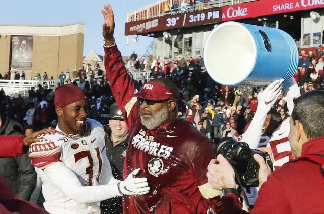 Florida State interim head coach Odell Haggins is doused after his team beat Boston College in an NCAA college football game, Saturday, Nov. 9, 2019, in Boston. (AP Photo/Bill Sikes)