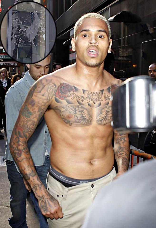 "After smashing the window of his dressing room as a result of being questioned on ""Good Morning America"" Tuesday about his 2009 assault of then-girlfriend Rihanna, Chris Brown stormed out of the studio shirtless. The singer later apologized for his actions, telling BET's ""106 & Park,"" ""I didn't try to hurt anyone. I just wanted to release the anger that I had inside of me because I felt like I worked so hard for this music and I love my fans and I love to be able to make positive music, but I felt like people kept just trying to take it away from me."" <a href=""http://www.infdaily.com"" target=""new"">INFDaily.com</a> - March 22, 2011"