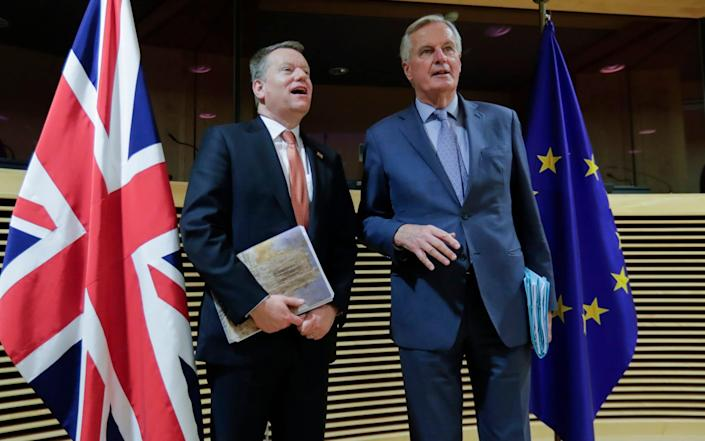 In this Monday, March 2, 2020 file photo, EU chief negotiator Michel Barnier, right, speaks with Britain's chief negotiator David Frost - Olivier Hoslet/Pool via AP/File