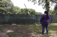 Carolyn Michael-Banks watches as workers dig up the remains of Confederate Gen. Nathan Bedford Forrest and his wife to move the bodies from Health Sciences Park June 4, 2021, in Memphis, Tenn. With the approval of relatives, the remains will be moved to the National Confederate Museum in Columbia, Tenn. (AP Photo/Karen Pulfer Focht)
