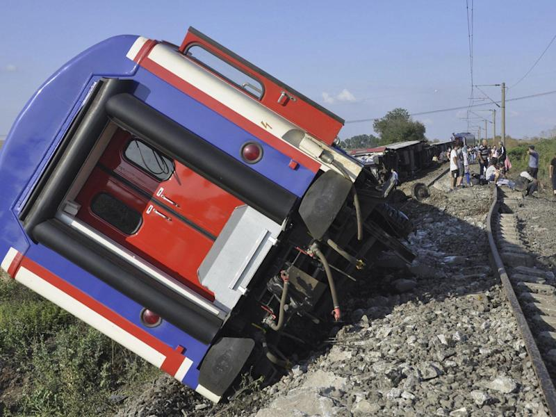 At least 10 people were killed when several carriages derailed after heavy rain: AP