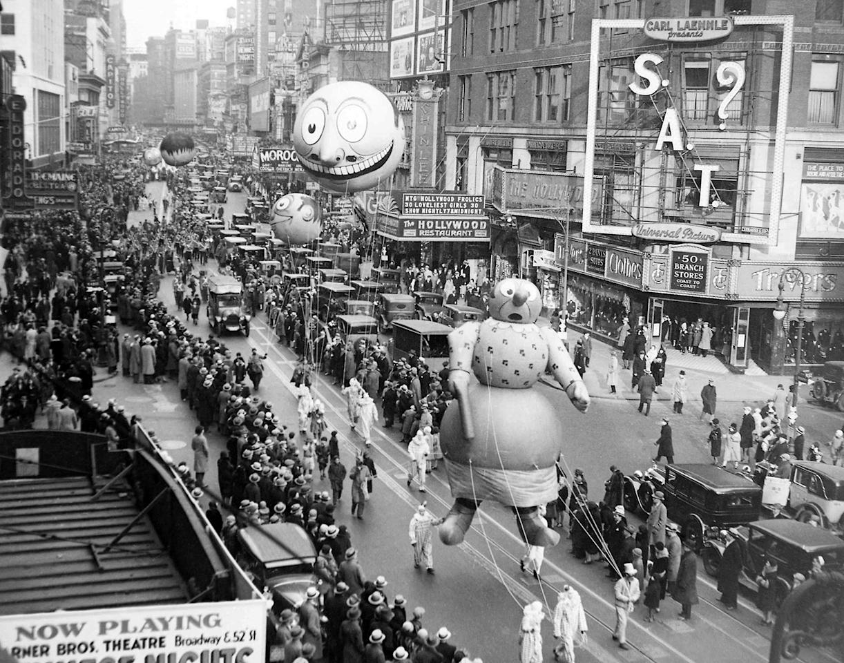 <p>The Macy's Thanksgiving Day Parade passes down Broadway in New York on Nov. 27, 1930. The parade's first giant balloons debuted in 1927. (Photo: AP) </p>