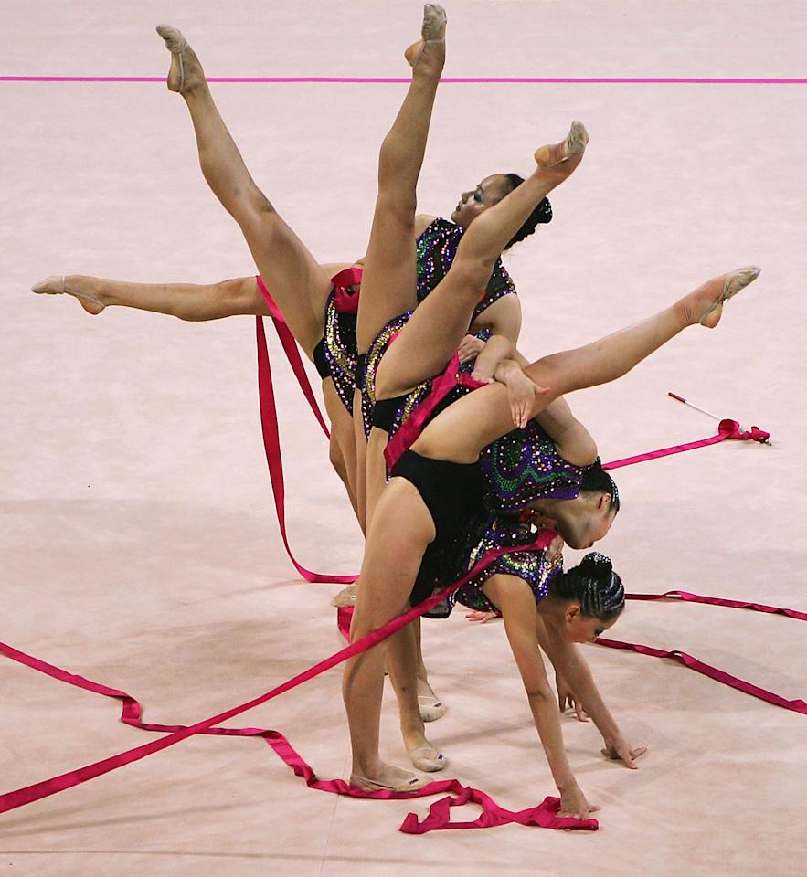 ATHENS - AUGUST 26:  China dances in the rhythmic gymnastics group qualifications on August 26, 2004 during the Athens 2004 Summer Olympic Games at the Galatsi Olympic Hall in Athens, Greece. (Photo by Mike Hewitt/Getty Images)