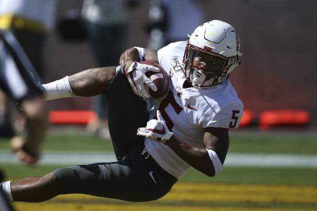 Washington State wide receiver Travell Harris makes a touchdown catch against Arizona State during the first half of an NCAA college football game Saturday, Oct. 12, 2019, in Tempe, Ariz. (AP Photo/Ross D. Franklin)
