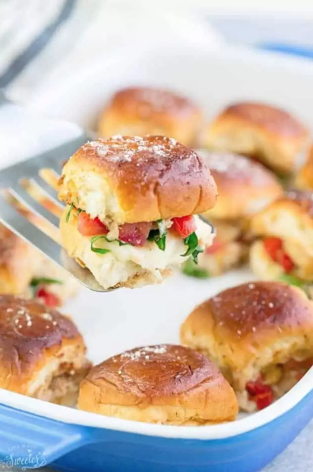 """<p>Build excitement for the main course with these bite-size delights, which you can make in the blink of an eye using rotisserie chicken. </p><p><strong>Get the recipe at <a href=""""https://lifemadesweeter.com/chicken-bruschetta-sliders/"""" rel=""""nofollow noopener"""" target=""""_blank"""" data-ylk=""""slk:Life Made Sweeter"""" class=""""link rapid-noclick-resp"""">Life Made Sweeter</a>. </strong> </p>"""