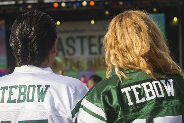 Jaime and Debbie Sandoval wait for New York Jets quarterback Tim Tebow to speak at Celebration Church's Easter service in Georgetown, Texas, April 8, 2012. (AP Photo/William Philpott)