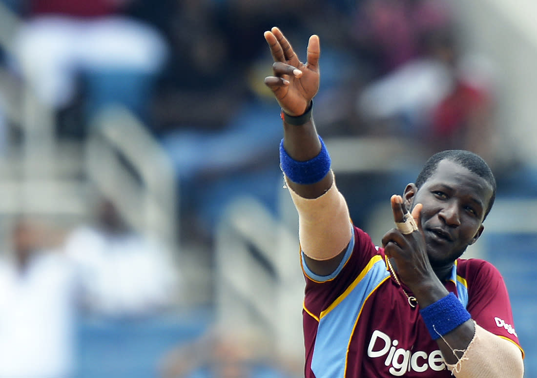 West Indies cricketer Darren Sammy fires an imaginary gun after dismissing Indian batsman Rohit Sharma during the second match of the Tri-Nation series between Indian and West Indies at the Sabina Park stadium in Kingston on June 30, 2013.  AFP Photo/Jewel Samad
