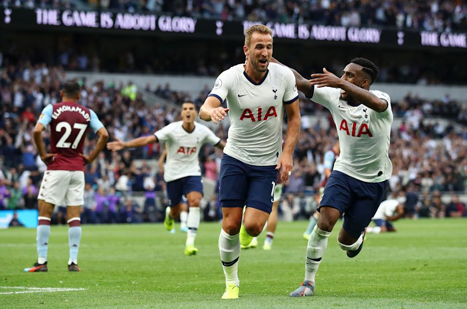 LONDON, ENGLAND - AUGUST 10: Harry Kane of Tottenham Hotspur celebrates with teammate Danny Rose after scoring his team's second goal during the Premier League match between Tottenham Hotspur and Aston Villa at Tottenham Hotspur Stadium on August 10, 2019 in London, United Kingdom. (Photo by Julian Finney/Getty Images)