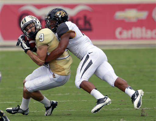 Central Florida wide receiver J.J. Worton (9) is tackled by Missouri defensive back Randy Ponder after a short reception during the first half of an NCAA college football game, Saturday, Sept. 29, 2012, in Orlando, Fla. (AP Photo/John Raoux)