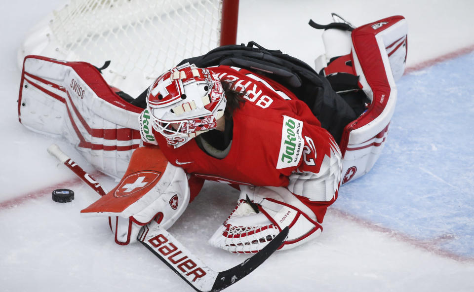 Switzerland goalie Andrea Braendli blocks the net against a shot from the United States during the third period of an IIHF women's hockey championship game in Calgary, Alberta, Friday, Aug. 20, 2021. (Jeff McIntosh/The Canadian Press via AP)