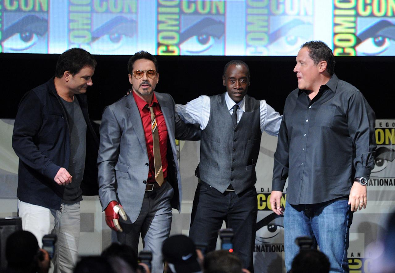 "SAN DIEGO, CA - JULY 14:  (L-R) Director Shane Black, actors Robert Downey Jr., Don Cheadle, and Jon Favreau speak at Marvel Studios ""Iron Man 3"" panel during Comic-Con International 2012 at San Diego Convention Center on July 14, 2012 in San Diego, California.  (Photo by Kevin Winter/Getty Images)"