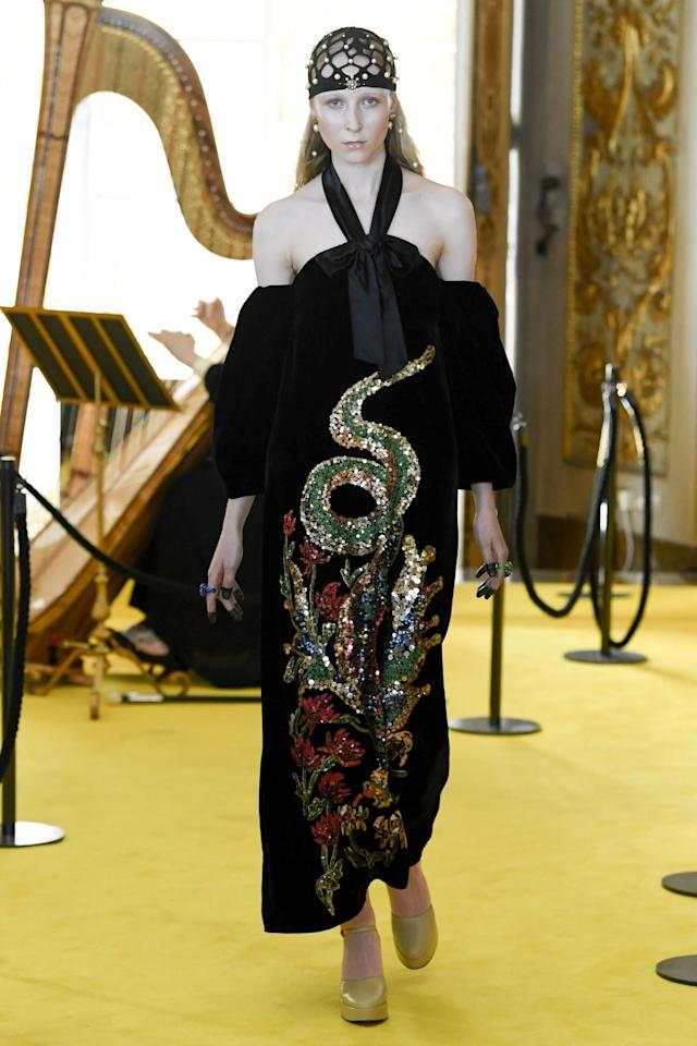 "<p>The <a href=""https://www.yahoo.com/style/tagged/Gucci"" data-ylk=""slk:Gucci"" class=""link rapid-noclick-resp"">Gucci </a>resort show in Florence, Italy, Monday night finally concludes the big fashion houses' round-the-world <a href=""https://www.yahoo.com/style/charlize-theron-demi-moore-freida-pinto-brave-mountains-l-dior-resort-show-195400075.html"" data-ylk=""slk:resort extravaganza"" class=""link rapid-noclick-resp"">resort extravaganza</a> month. Creative director Alessandro Michele did not disappoint his gang of Gucci worshippers.<br>A model in a black velvet halter-neck dress with heavy embroidery walks the runway in Florence for Gucci's Resort 2018 show. (Photo: Getty Images) </p>"