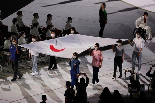 The Paralympic flag is brought in during the opening ceremony of the Tokyo 2020 Paralympic Games at the Olympic Stadium. (Photo: Alex Pantling via Getty Images)