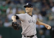 New York Yankees pitcher J.A. Happ works against the Oakland Athletics during the first inning of a baseball game Wednesday, Aug. 21, 2019, in Oakland, Calif. (AP Photo/Ben Margot)