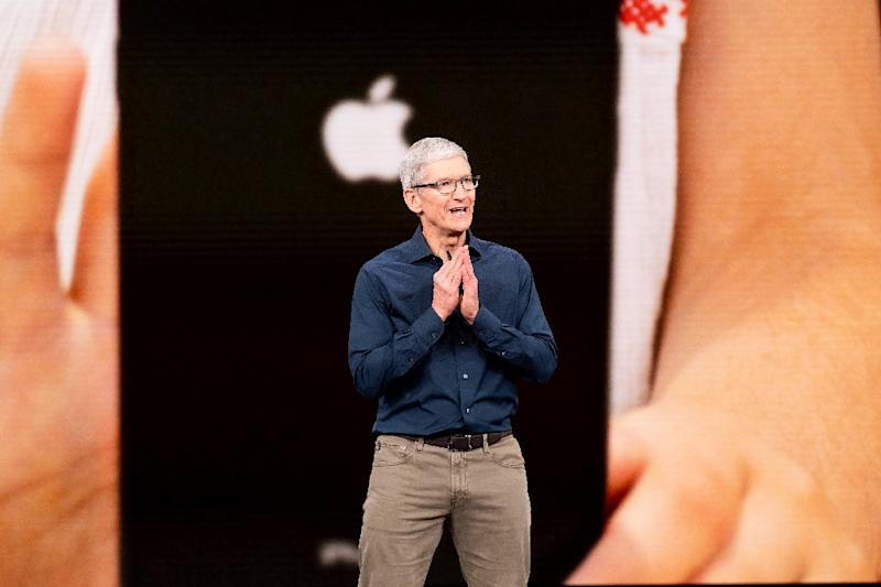 Apple, whose CEO Tim Cook is seen here at the September 12 iPhone launch event, won't face an immediate impact from new tariffs on Chinese-made goods (AFP Photo/NOAH BERGER)