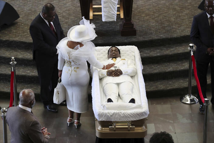 Tomika Miller, the wife of Rayshard Brooks, touches her husband during a family visit just before a public viewing begins at Ebenezer Baptist Church on Monday, Jun 22, 2020 in Atlanta. Brooks, 27, died June 12 after being shot by an officer in a Wendy's parking lot. Brooks' death sparked protests in Atlanta and around the country. A private funeral for Brooks will be held Tuesday at the church. (Curtis Compton/Atlanta Journal-Constitution via AP, Pool)