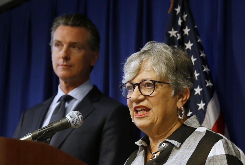 FILE - In this Sept. 18, 2019, file photo, California Air Resources Board Chair Mary Nichols, with California Gov. Gavin Newsom at left, discusses the Trump administration's pledge to revoke California's authority to set vehicle emissions standards that are different than the federal standards, during a news conference in Sacramento, Calif. Nichols' term leading the state ARB ends in December 2020. She's held the role since 2007 after an earlier stint as chair in the early 1980s. (AP Photo/Rich Pedroncelli, File)