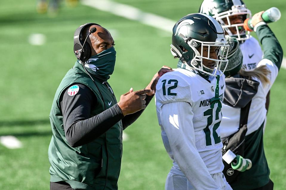 Michigan State's head coach Mel Tucker, left, talks with Chris Jackson during the second quarter of the game against Michigan on Saturday, Oct. 31, 2020, at Michigan Stadium in Ann Arbor.