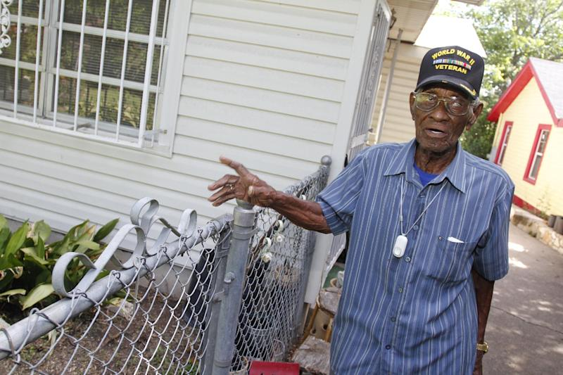 107-year-old Richard Overton, the oldest recorded living US veteran, surveys the backyard of his home after being presented with the Philips Lifeline with AutoAlert service on Wednesday, June 5, 2013 in Austin, Texas. The medical alert service, which will help protect Overton as he continues to remain independent in his home, was provided free of charge for the rest his life in appreciation for his courageous service to our country. Overton served for the Army in the Pacific during World War II.(Jack Plunkett / AP Images for Philips Lifeline)