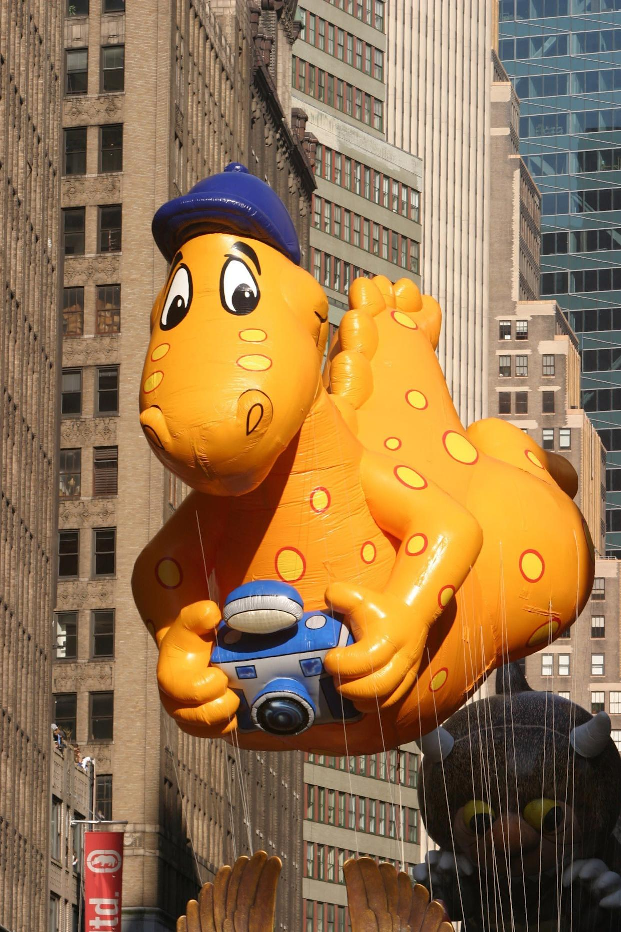 """This dino is solely responsible for kids of the 2000s asking their parents for a <a href=""""http://www.youtube.com/watch?v=SmGl2Qx1uDQ"""" rel=""""nofollow noopener"""" target=""""_blank"""" data-ylk=""""slk:cheese slip n' slide"""" class=""""link rapid-noclick-resp"""">cheese slip n' slide</a>."""