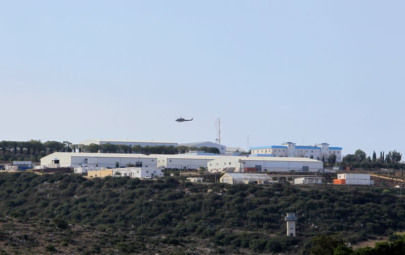 An aircraft flies over a base for U.N. peacekeepers of the United Nations Interim Force in Lebanon (UNIFIL) in Naqoura