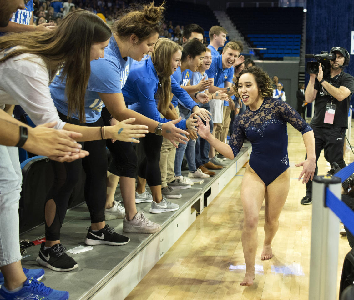UCLA Bruins' Katelyn Ohashi celebrates with the student section during an NCAA college gymnastics meet against Arizona State in Los Angeles Monday, Jan. 21, 2019. (Photo by Kyusung Gong/Icon Sportswire via Getty Images)