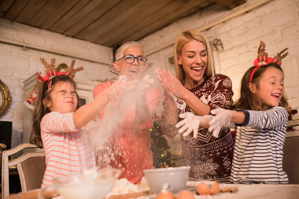 Female part of the family making a cake together and having fun
