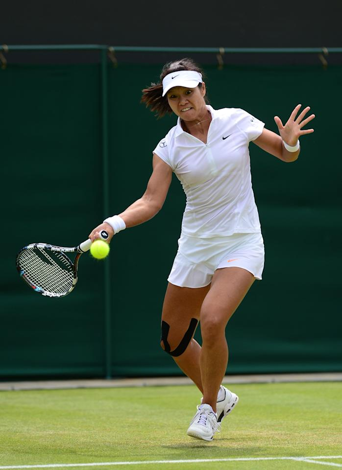 LONDON, ENGLAND - JUNE 27: Na Li of China plays a forehand during the Ladies' Singles second round match against Simona Halep of Romania on day four of the Wimbledon Lawn Tennis Championships at the All England Lawn Tennis and Croquet Club on June 27, 2013 in London, England. (Photo by Mike Hewitt/Getty Images)