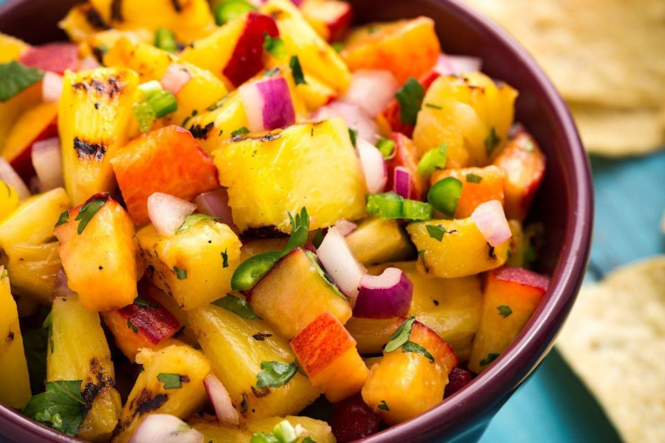 """<p>This is bound to become your new favorite salsa.</p><p>Get the recipe from <a href=""""https://www.delish.com/cooking/recipe-ideas/recipes/a47362/grilled-pineapple-salsa-recipe/"""" rel=""""nofollow noopener"""" target=""""_blank"""" data-ylk=""""slk:Delish"""" class=""""link rapid-noclick-resp"""">Delish</a>. </p>"""