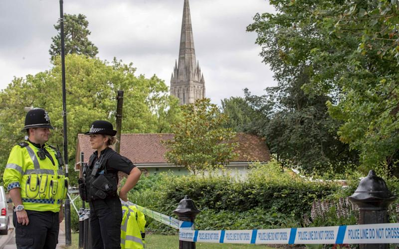A police officer stands at a cordon outside Queen Elizabeth Gardens in Salisbury