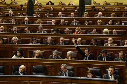Spain passes massive crisis cutbacks