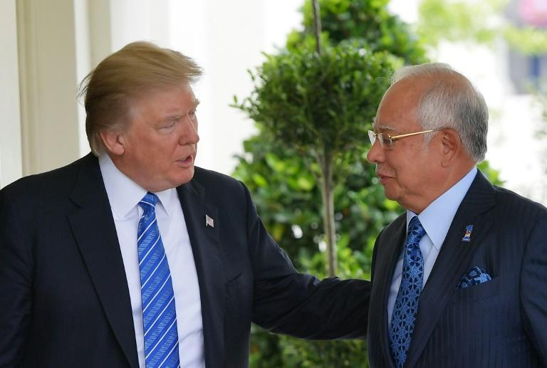 US President Donald Trump greets Malaysian Prime Minister Najib Razak outside of the West Wing of the White House