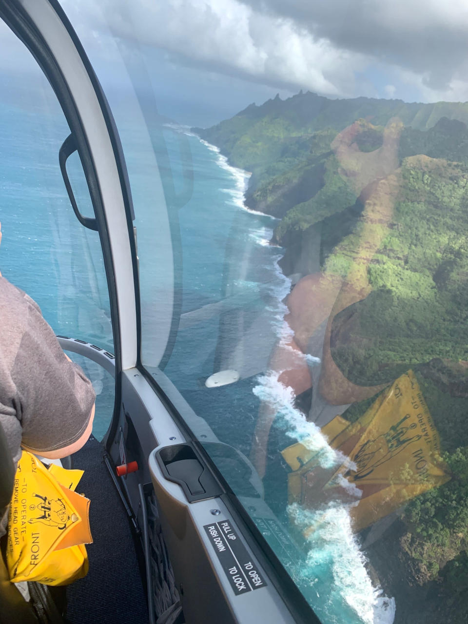 FILE - This Dec. 17, 2019 file photo shows the Na Pali Coast on the island of Kauai in Hawaii. The small, tight-knit community of about 72,000 people on Kauai spent the first seven months of the pandemic mostly COVID-free. Then in October, statewide travel restrictions eased and the pandemic came pouring in. (AP Photo/Maryclaire Dale, File)